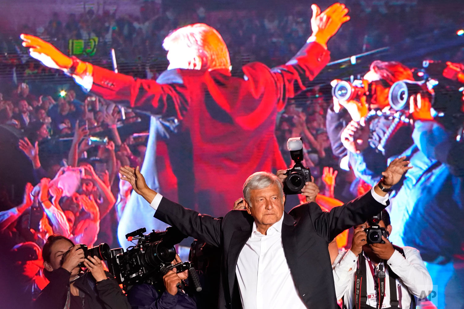 In this June 27, 2018 photo, presidential candidate Andres Manuel Lopez Obrador waves to supporters at his closing campaign rally at Azteca stadium in Mexico City. Lopez Obrador became Mexico's first leftist president in over 70 years, marking a turning point in one of the world's most radical experiments in opening markets and privatization. (AP Photo/Ramon Espinosa)