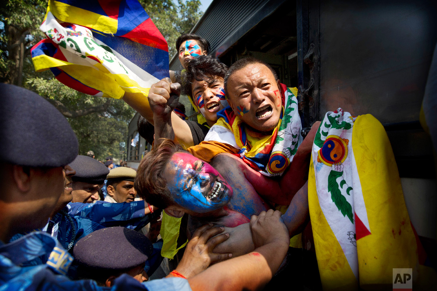 Indian para-military force soldiers push exiled Tibetan activists into a police bus during a protest outside the Chinese Embassy, in New Delhi, India, on March 9, 2018. (AP Photo/Manish Swarup)