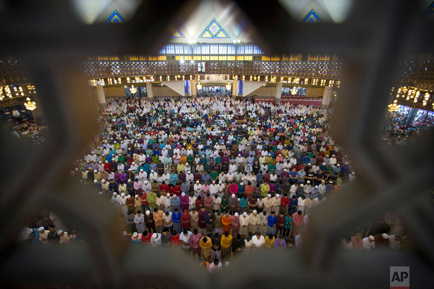 Malaysian Muslims offer prayers during the first day of Eid al-Fitr, which marks the end of the holy fasting month of Ramadan in Kuala Lumpur, Malaysia, on June 15, 2018. (AP Photo/Vincent Thian)