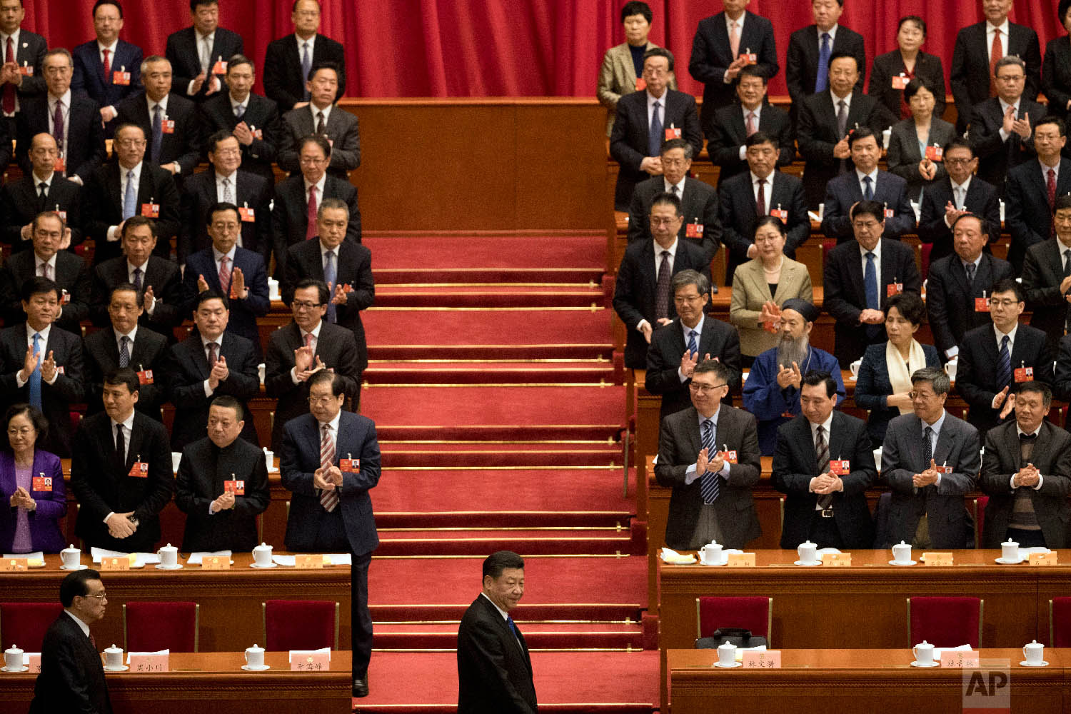 Chinese President Xi Jinping, center, arrives with Premier Li Keqiang, left, for the opening session of the Chinese People's Political Consultative Conference in Beijing's Great Hall of the People on March 3, 2018. (AP Photo/Ng Han Guan)