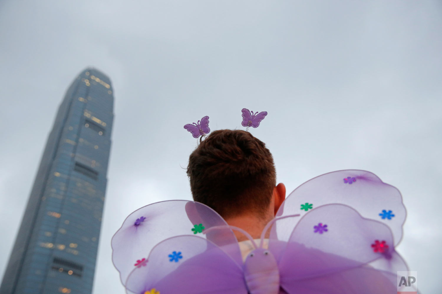 A participant attends the annual Pride Parade In Hong Kong, Saturday, Nov. 17, 2018. Thousands of supporters and members of the Lesbian, Gay, Bisexual, Transgender (LGBT) community in Hong Kong gathered on Saturday to participate in the annual Pride Parade. (AP Photo/Kin Cheung)