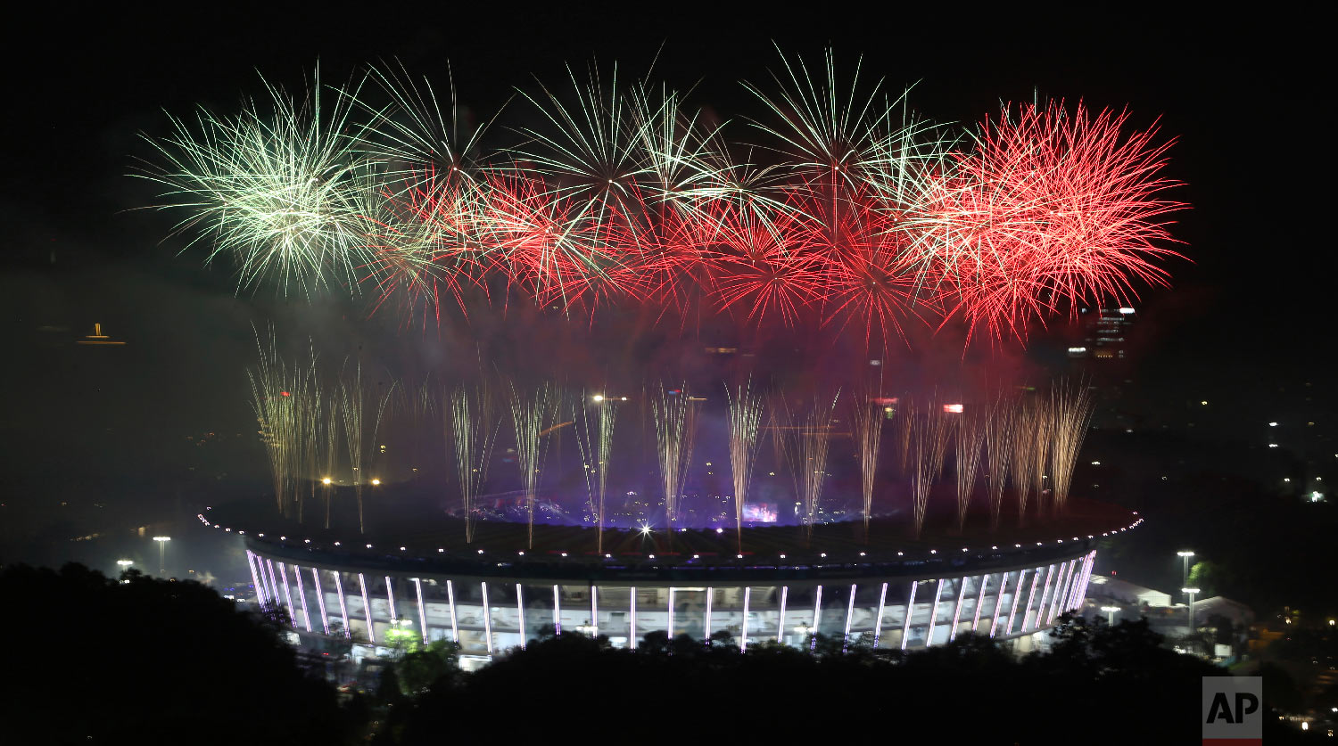 Fireworks explode over the Gelora Bung Karno Stadium during the closing ceremony for the 18th Asian Games at in Jakarta, Indonesia, Sunday, Sept. 2, 2018. (AP Photo/Achmad Ibrahim)
