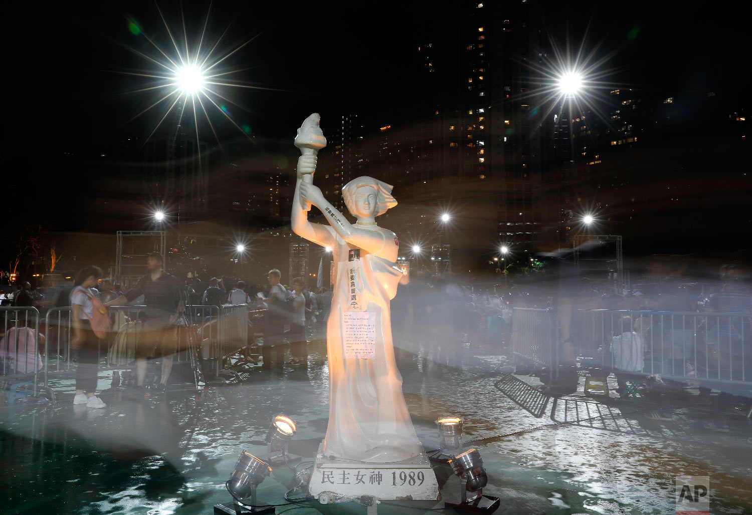 "A statue of the ""Goddess of Democracy"" is displayed as tens of thousands of people attend an annual candlelight vigil at Hong Kong's Victoria Park, Monday, June 4, 2018. Hong Kongers commemorate victims of the Chinese government's brutal military crackdown nearly three decades ago on protesters in 1989 Beijing's Tiananmen Square. (AP Photo/Vincent Yu)"