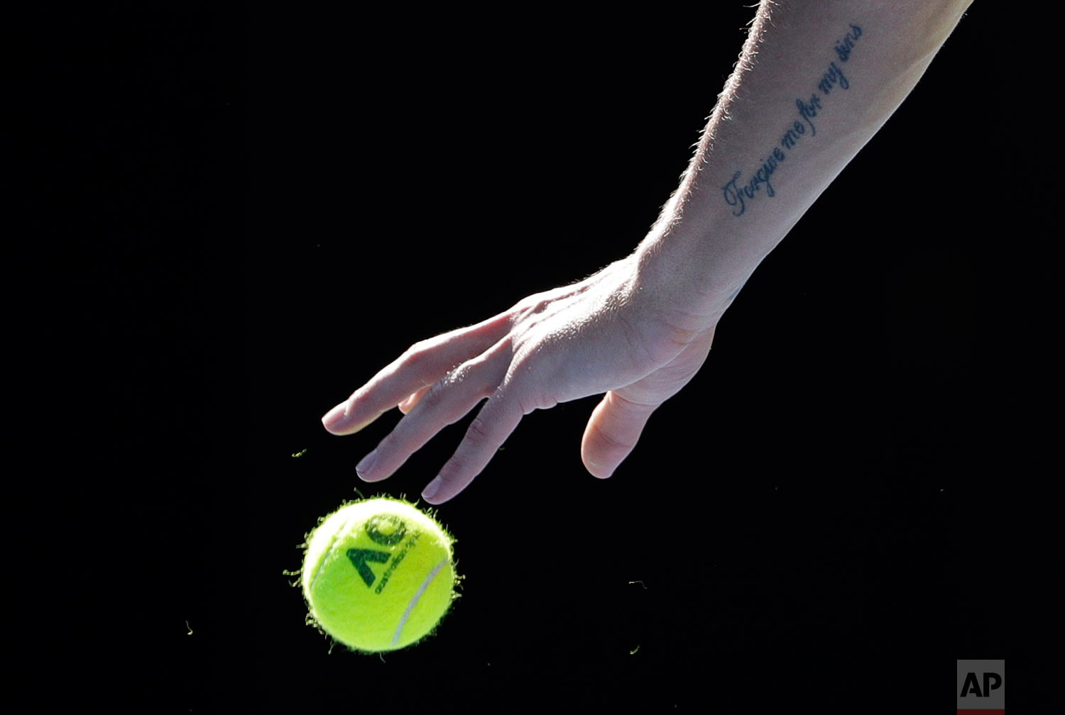 Hungary's Marton Fucsovics prepares to serve to Switzerland's Roger Federer during their fourth round match at the Australian Open tennis championships in Melbourne, Australia, Monday, Jan. 22, 2018. (AP Photo/Dita Alangkara)