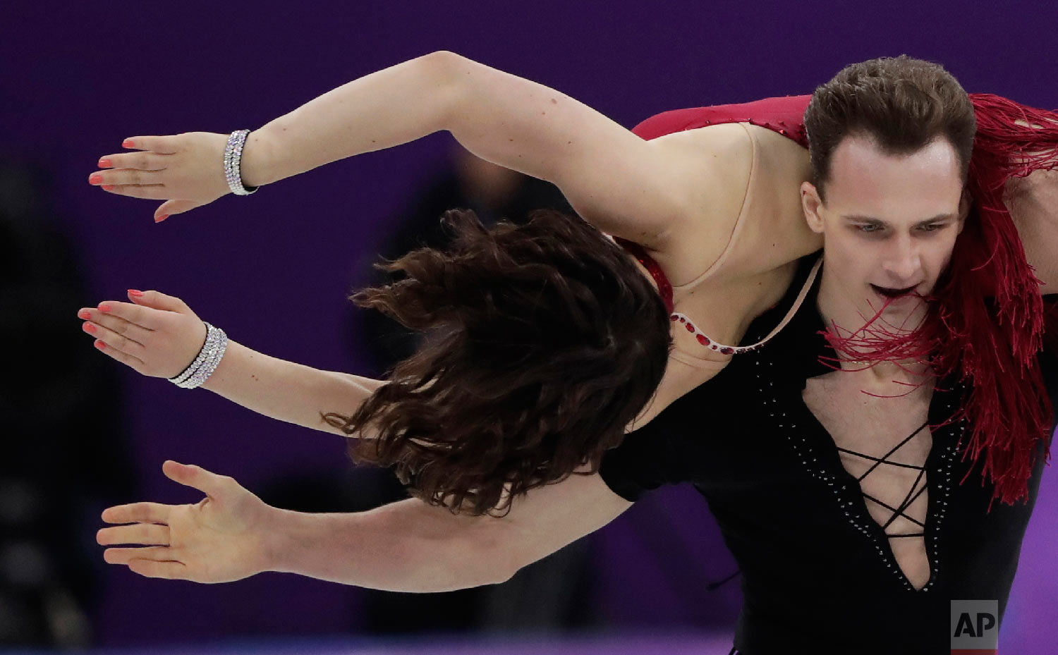 Natalia Kaliszek and Maksym Spodyriev of Poland perform during the ice dance, short dance figure skating in the Gangneung Ice Arena at the 2018 Winter Olympics in Gangneung, South Korea, Monday, Feb. 19, 2018. (AP Photo/Julie Jacobson)