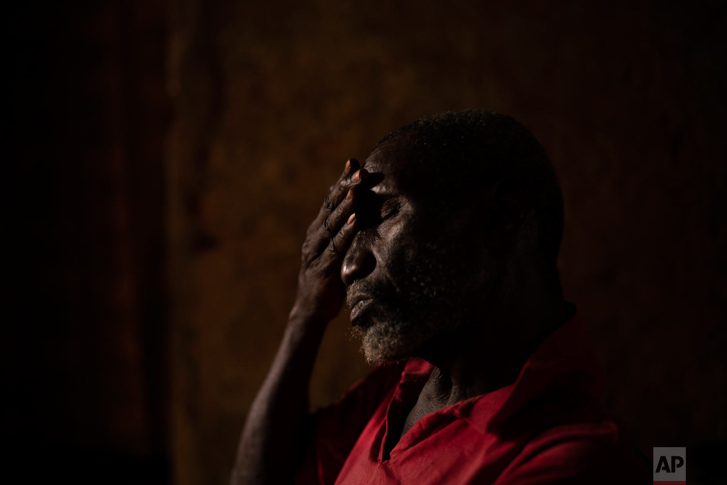 Cheikh Fofana reacts while talking about his missing son as he sits inside his house on Nov. 23, 2018, in Goudiry, Senegal. (AP Photo/Felipe Dana)