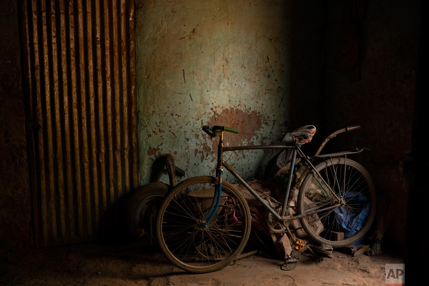 Cheikh Fofana's bicycle is parked inside his house on Nov. 27, 2018, in Goudiry, Senegal. (AP Photo/Felipe Dana)