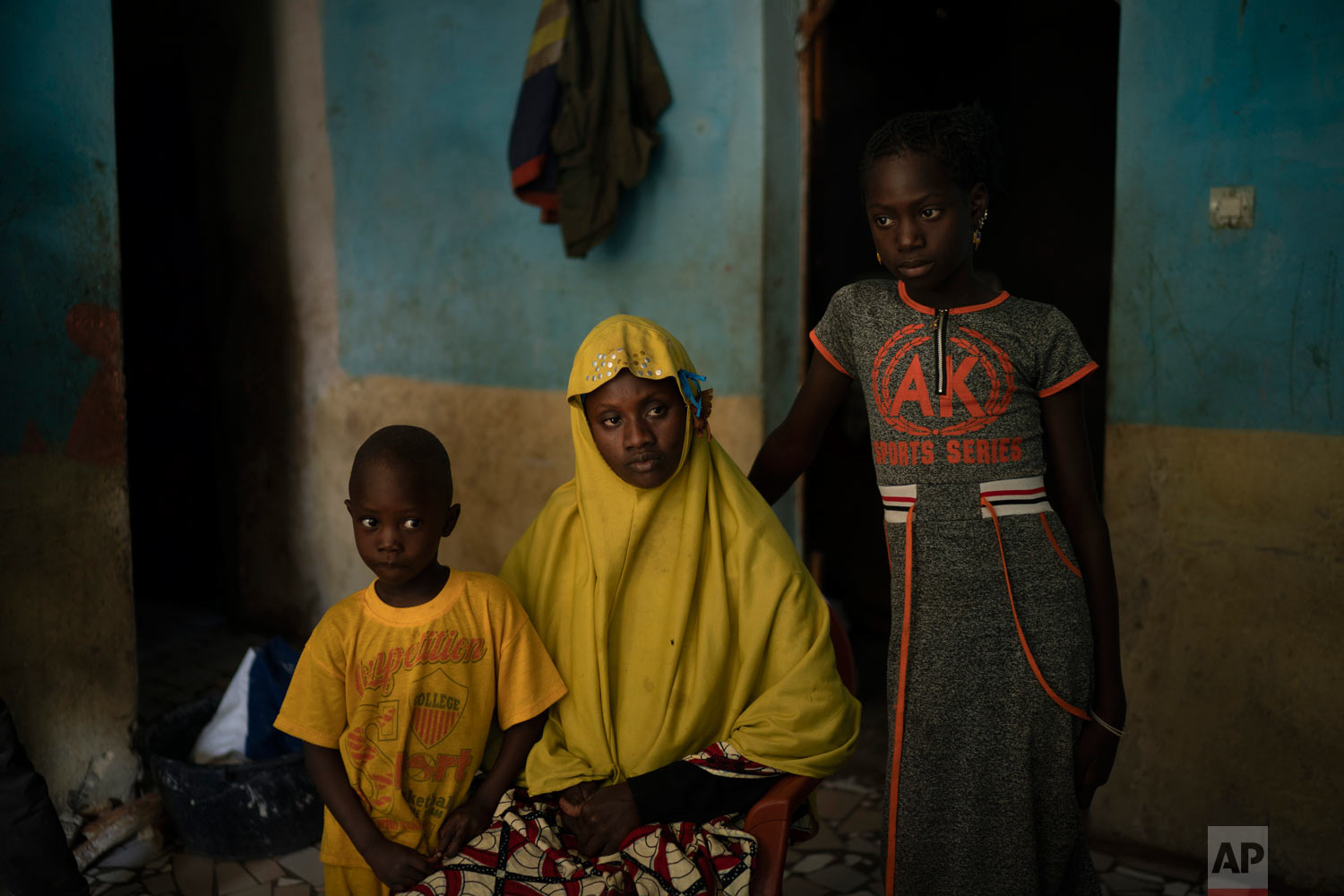 Mariama Konte, 20, sits with her daughter Maimouna, 7, and her son Ibrahima, 4, inside their home on Nov. 24, 2018, in a village near Goudiry, Senegal. Konte, who married Abdrahamane when she was 12 and he was 21, is living the consequences of the family's decision in November to mourn him after nearly four years of waiting. (AP Photo/Felipe Dana)