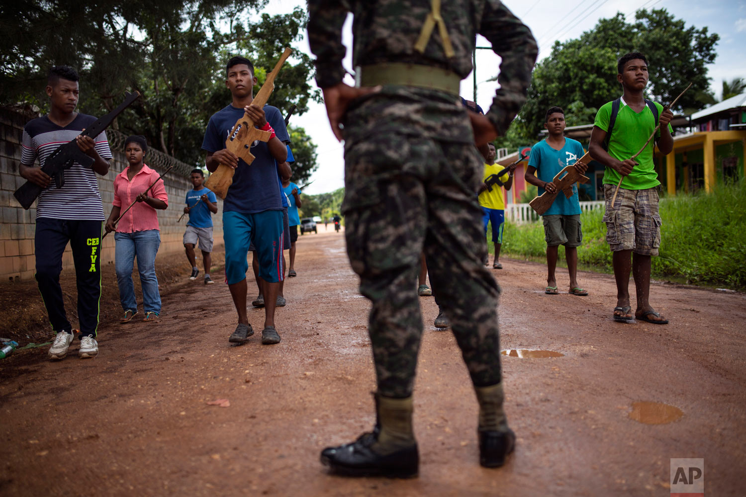 In this Feb 5, 2018 photo, students practice their routine to perform in an independence military parade supervised by a Honduran Army soldier, in Puerto Lempira, Honduras. (AP Photo/Rodrigo Abd)
