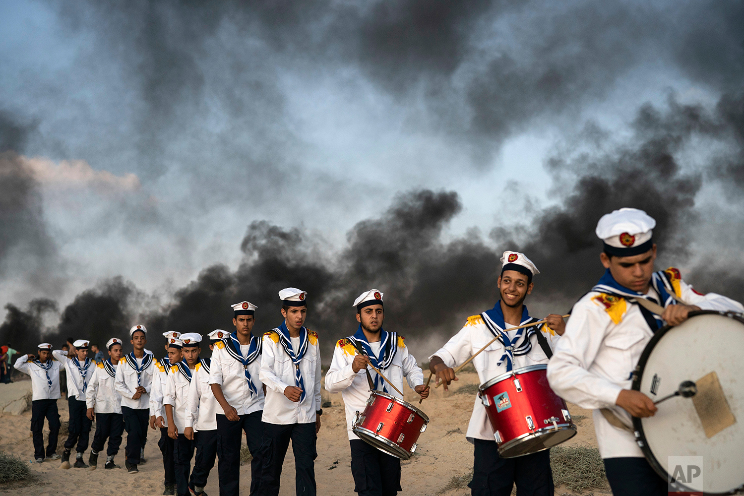 Palestinian boy scouts march during a protest on the beach near the border with Israel in Beit Lahiya, northern Gaza Strip, Monday, Sept. 10, 2018. (AP Photo/Felipe Dana)