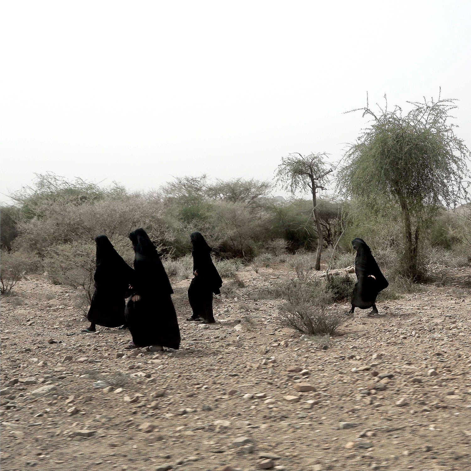 In this July 24, 2018 photo, women make their way on the road in Shabwa, Yemen. (AP Photo/Nariman El-Mofty)