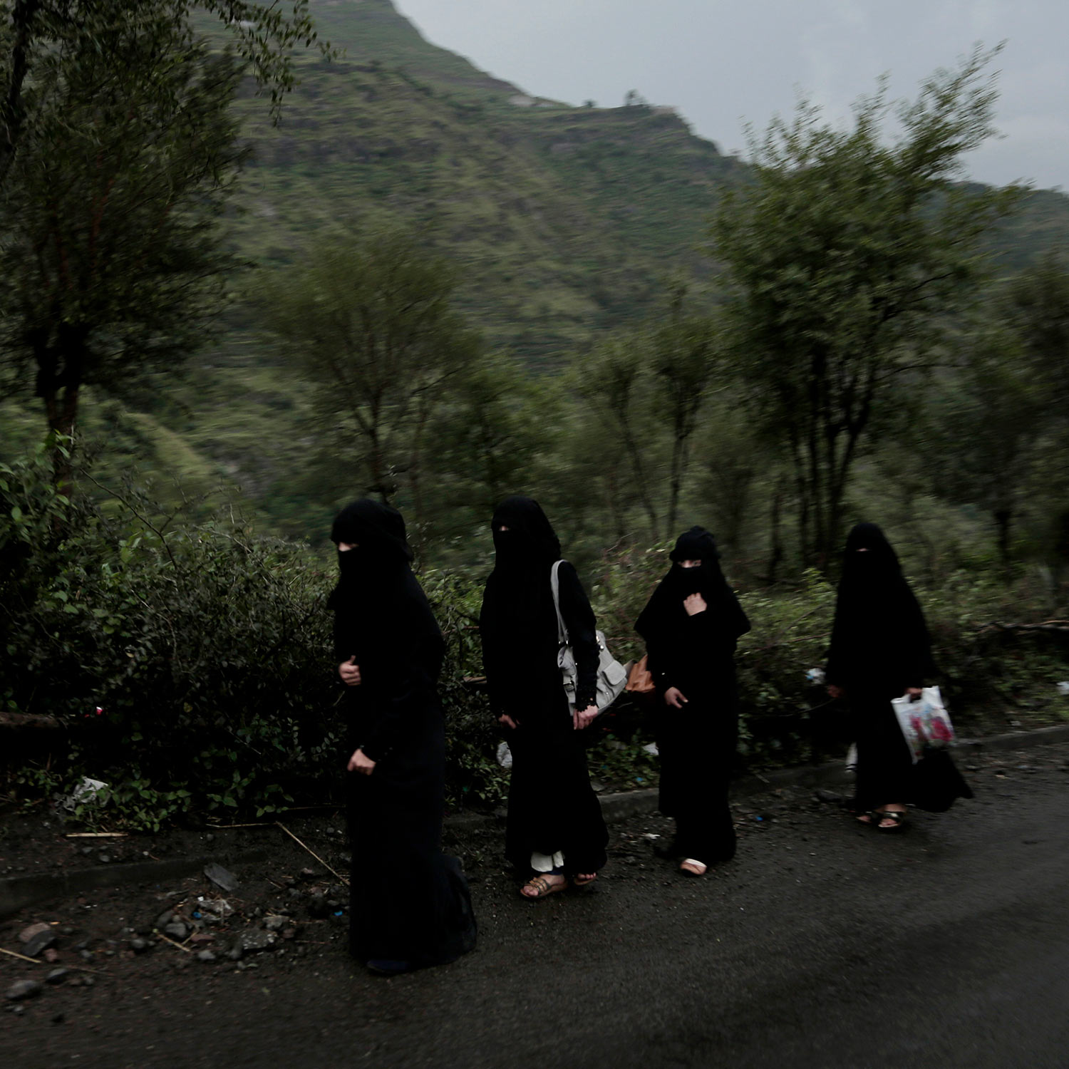 In this Aug. 3, 2018 photo, women walk on a road in Ibb, Yemen. (AP Photo/Nariman El-Mofty)