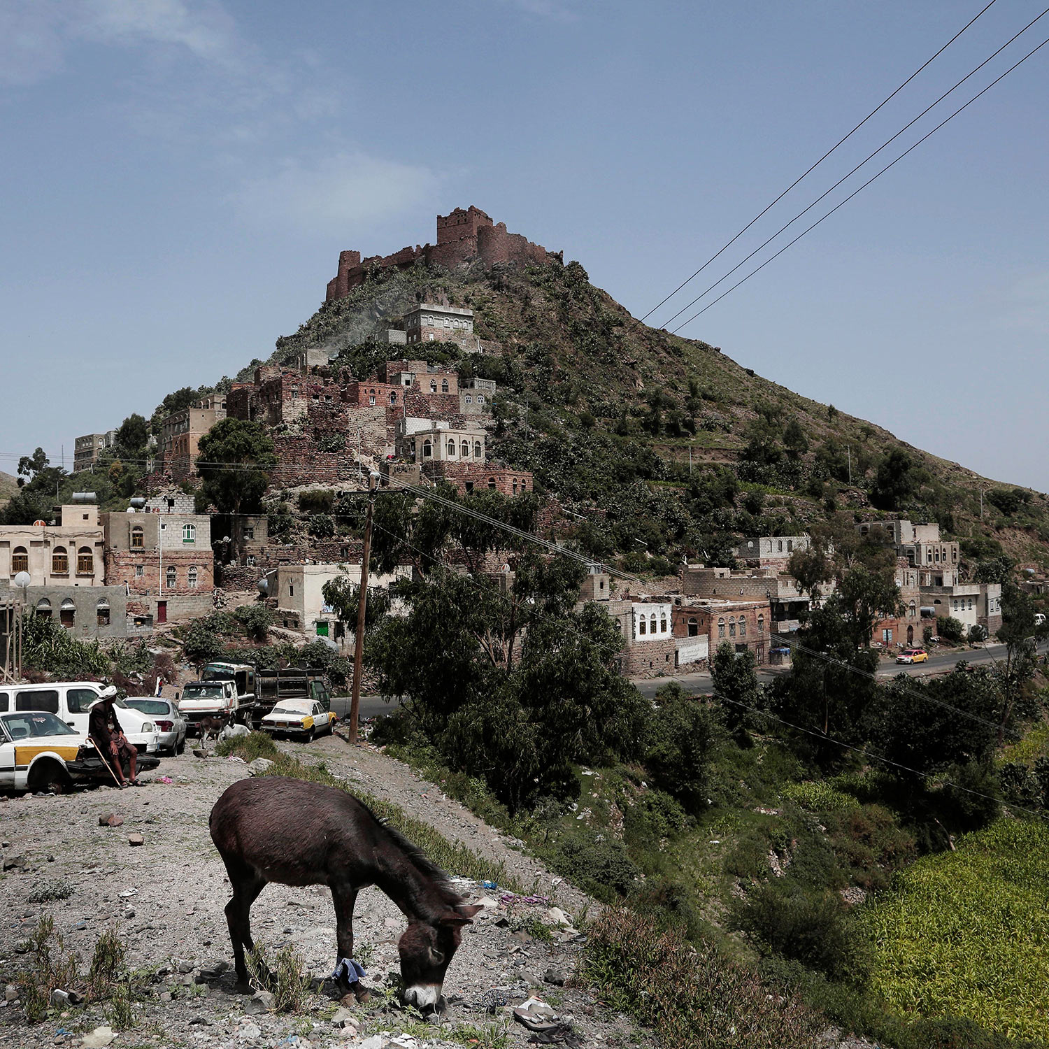 This Aug. 3, 2018 photo, shows antiquities site, top, known as Samara Castle, in Ibb, Yemen. (AP Photo/Nariman El-Mofty)