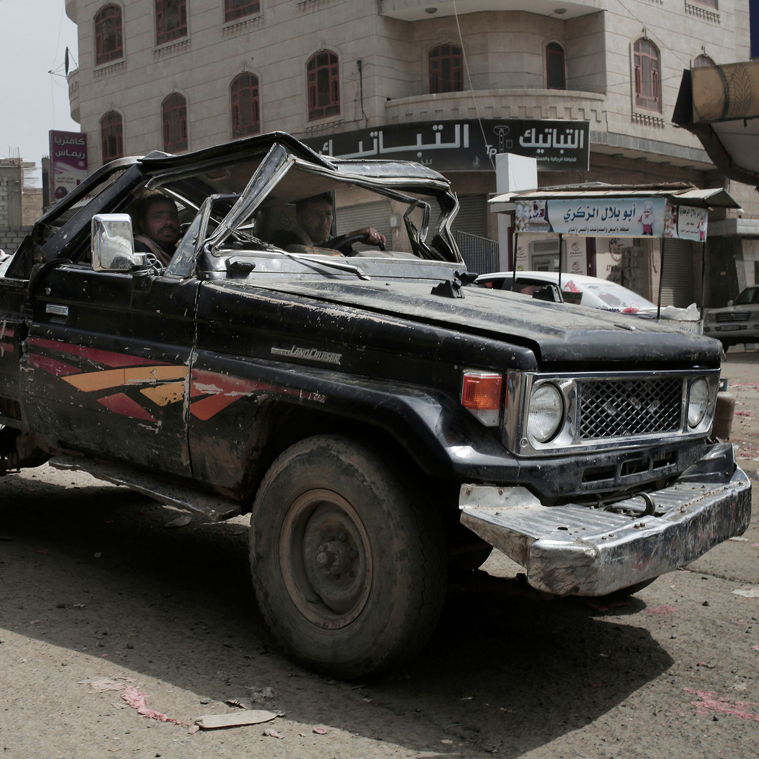 In this Aug. 3, 2018 photo, a man drives a damaged vehicle on a street in Ibb, Yemen. (AP Photo/Nariman El-Mofty)