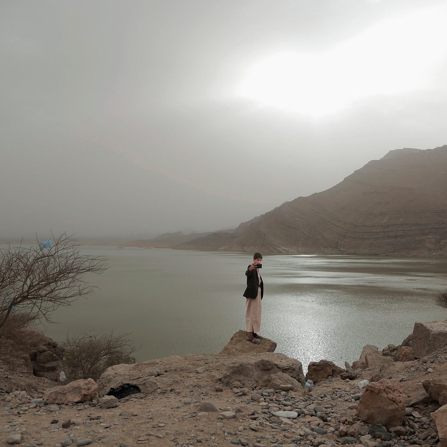 In this July 30, 2018 photo, a boy takes a 'selfie' with the Marib Dam in Yemen. (AP Photo/Nariman El-Mofty)