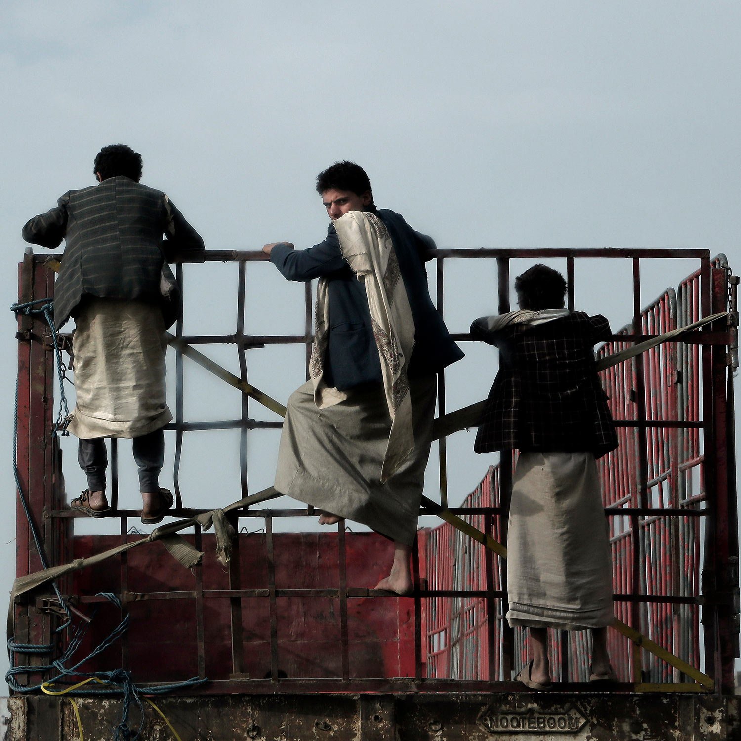 In this Aug. 6, 2018 photo, boys jump on the back of a pick-up truck in Sanaa, Yemen. (AP Photo/Nariman El-Mofty)