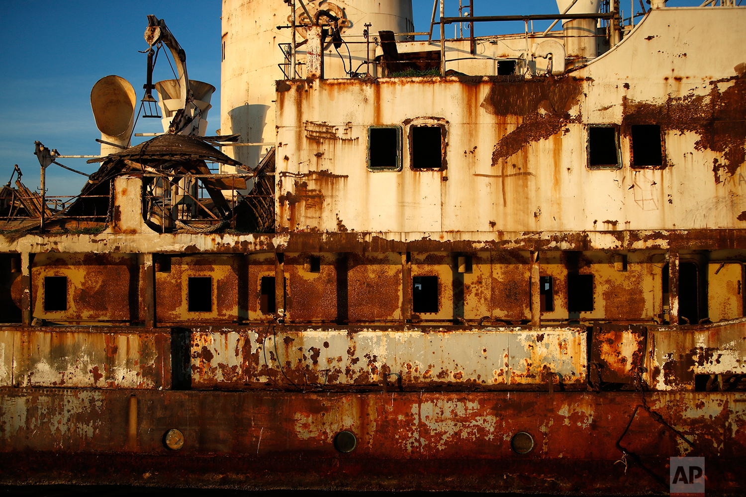 In this Friday, Dec. 4, 2018 photo, an abandoned ship is tied up in the Gulf of Elefsina, west of Athens. (AP Photo/Thanassis Stavrakis)