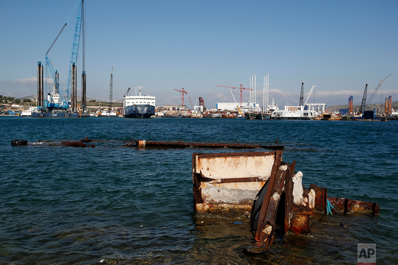 In this Tuesday, Nov. 6, 2018 photo, a half sunken floating platform near a shipyard in Salamina island, west of Athens. (AP Photo/Thanassis Stavrakis)