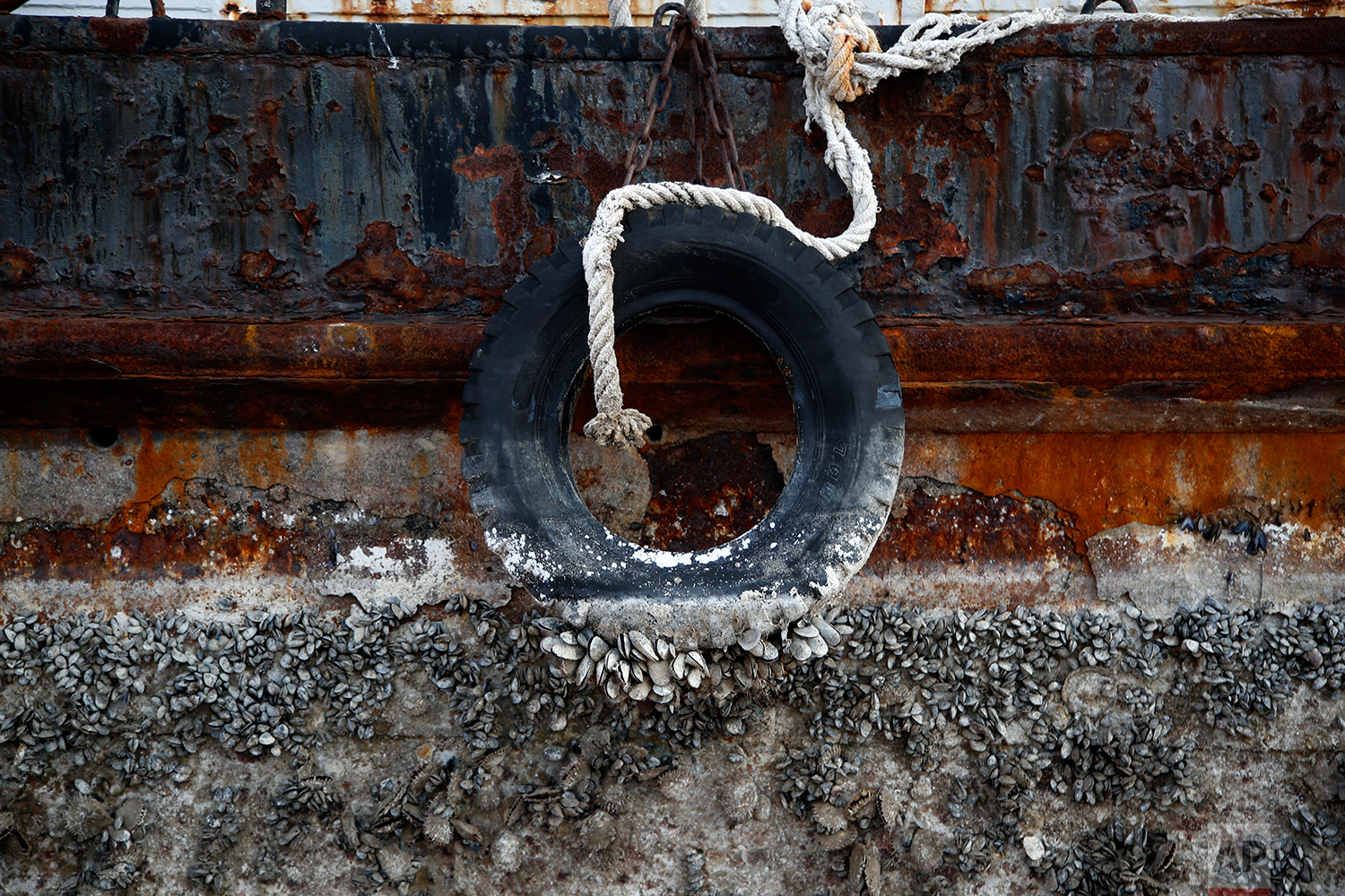 In this Tuesday, Nov. 13, 2018 photo, a small boat, that was recovered after spending years as a shipwreck is photographed at a dock in Elefsina, west of Athens. (AP Photo/Thanassis Stavrakis)