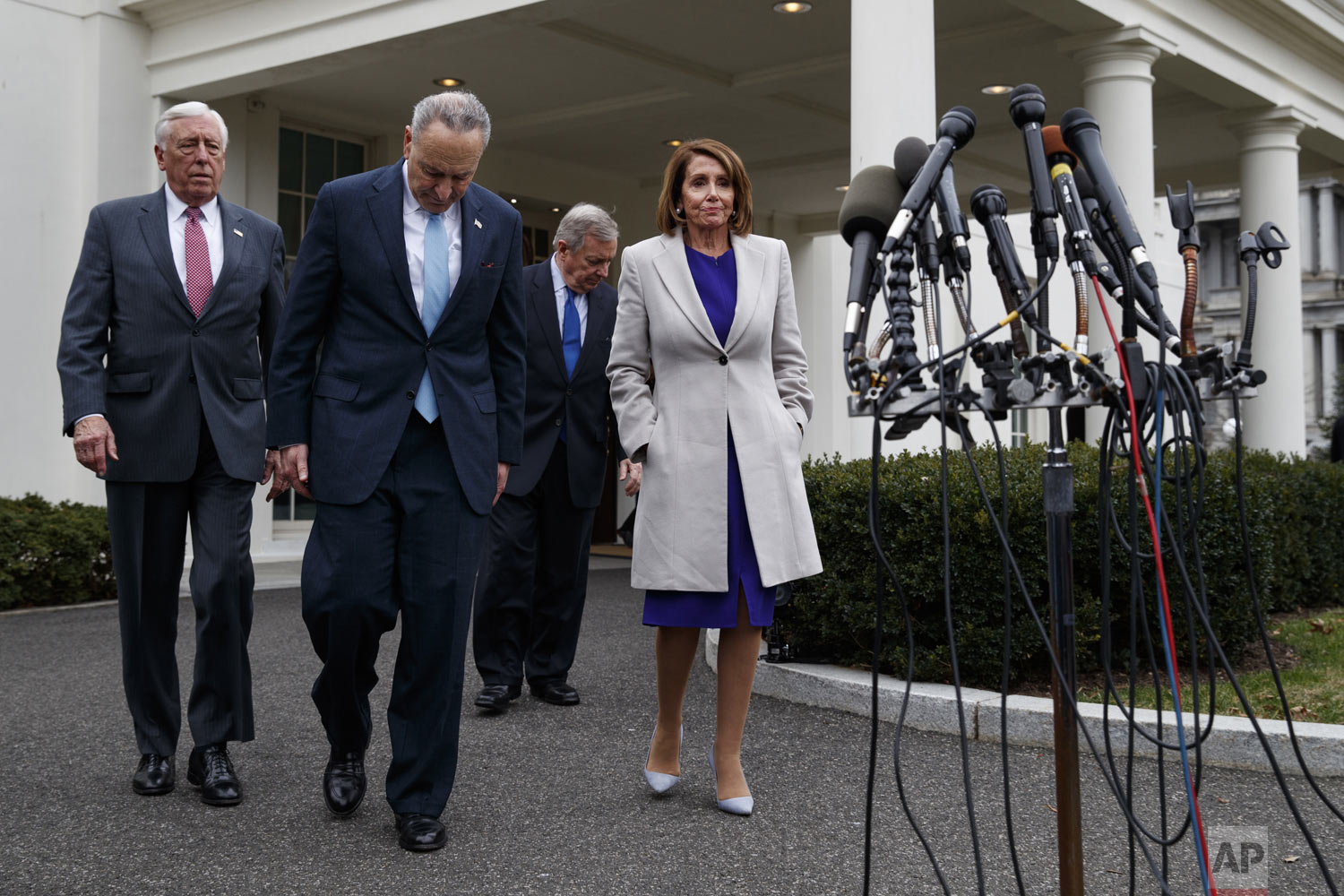 "From left, House Majority Leader Steny Hoyer of Md., Senate Minority Leader Chuck Schumer of N.Y., Sen. Dick Durbin, D-Ill., and Speaker of the House Nancy Pelosi of Calif., walk to speak to reporters after meeting with President Donald Trump about border security in the Situation Room of the White House, Friday, Jan. 4, 2018, in Washington. Trump declared Friday he could keep parts of the government shut down for ""months or even years"" as he and Democratic leaders failed in a second closed-door meeting to resolve his demand for billions of dollars for a border wall with Mexico. (AP Photo/Evan Vucci)"