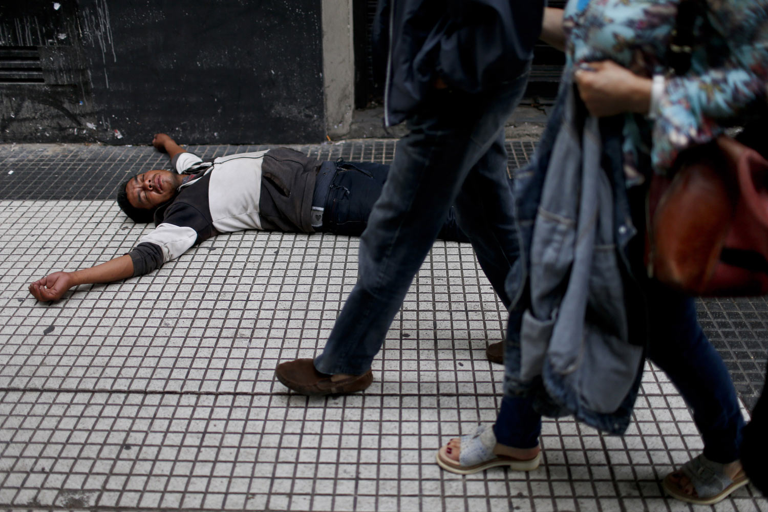 A man sleeps on a street in Buenos Aires, Argentina, Thursday, Jan. 10, 2019. The World Bank has slashed its forecast for 2019 growth for Turkey, Argentina, Iran and Pakistan, among others. (AP Photo/Natacha Pisarenko)