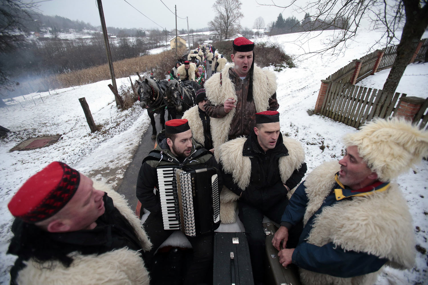 Bosnian Serb men sing and ride horses during a traditional Orthodox Christmas Eve parade, in the village of Glamocani, near Banja Luka, Bosnia, on Sunday, Jan. 6, 2019. Like many other Orthodox Christians around the world, Serbs observe holidays according to the Julian calendar instead of the Gregorian calendar adopted during the 16th century, celebrating Christmas on Jan. 7 instead of Dec. 25. (AP Photo/Amel Emric)