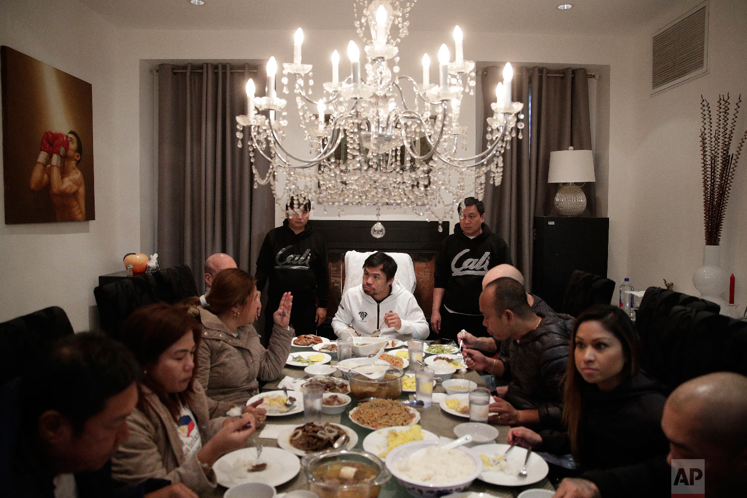 Boxer Manny Pacquiao, center, eats his breakfast with friends and relatives following his morning run Jan. 14, 2019, in Los Angeles. (AP Photo/Jae C. Hong)