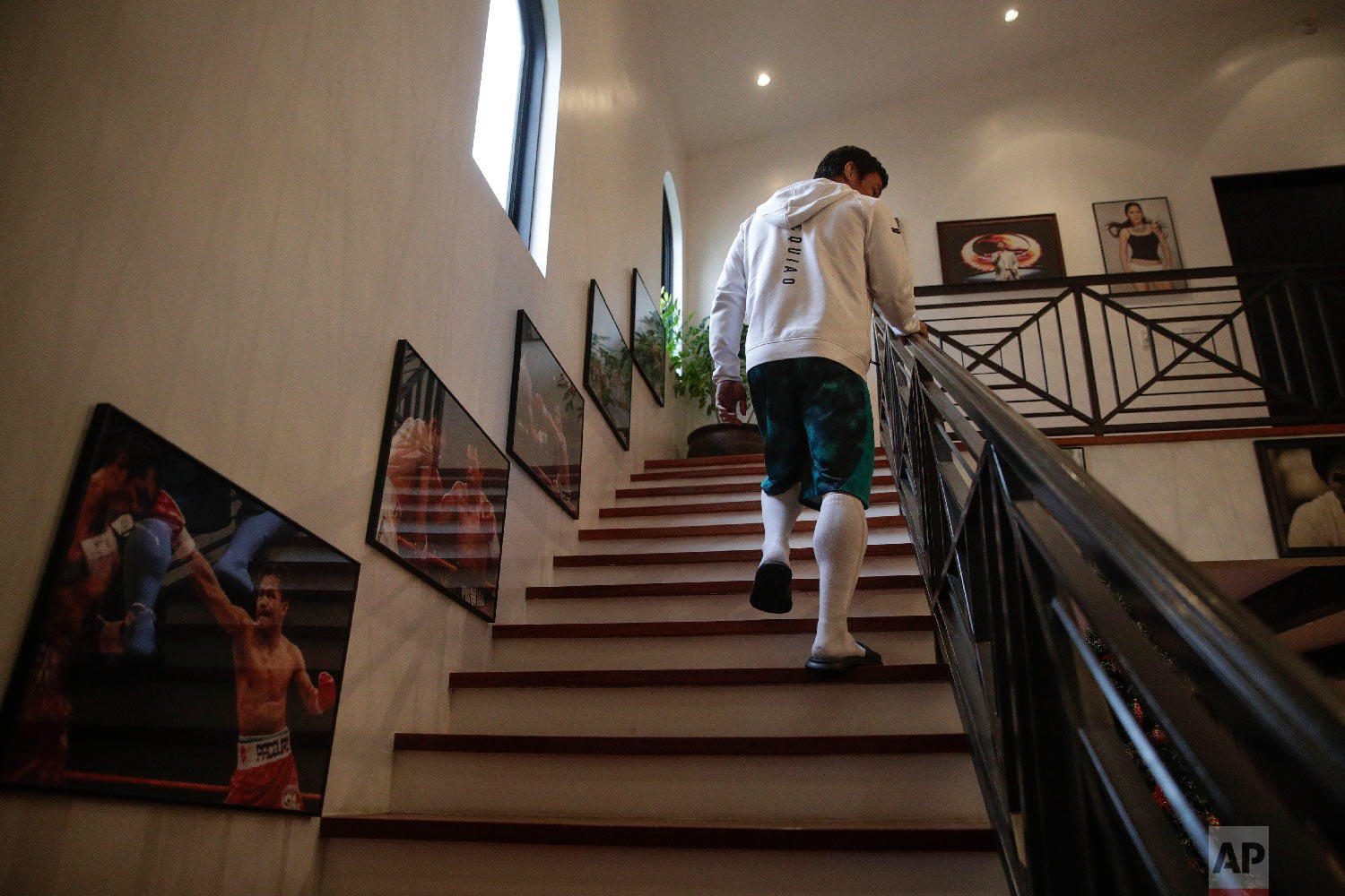 Boxer Manny Pacquiao walks up the steps to his bedroom for a nap following his morning run Jan. 14, 2019, in Los Angeles. (AP Photo/Jae C. Hong)