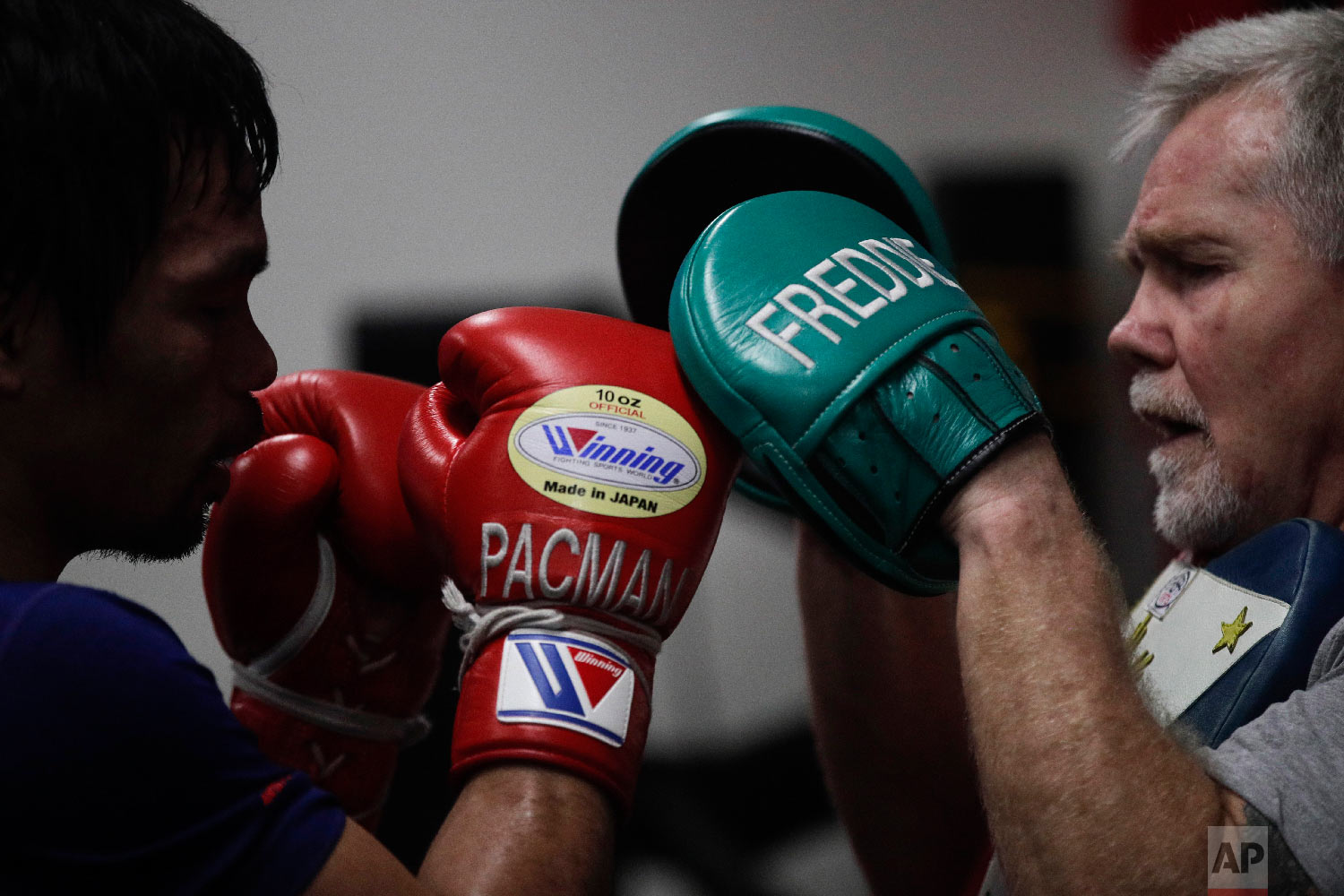 Boxer Manny Pacquiao, left, trains with Freddie Roach at the Wild Card Boxing Club on Jan. 14, 2019, in Los Angeles. (AP Photo/Jae C. Hong)
