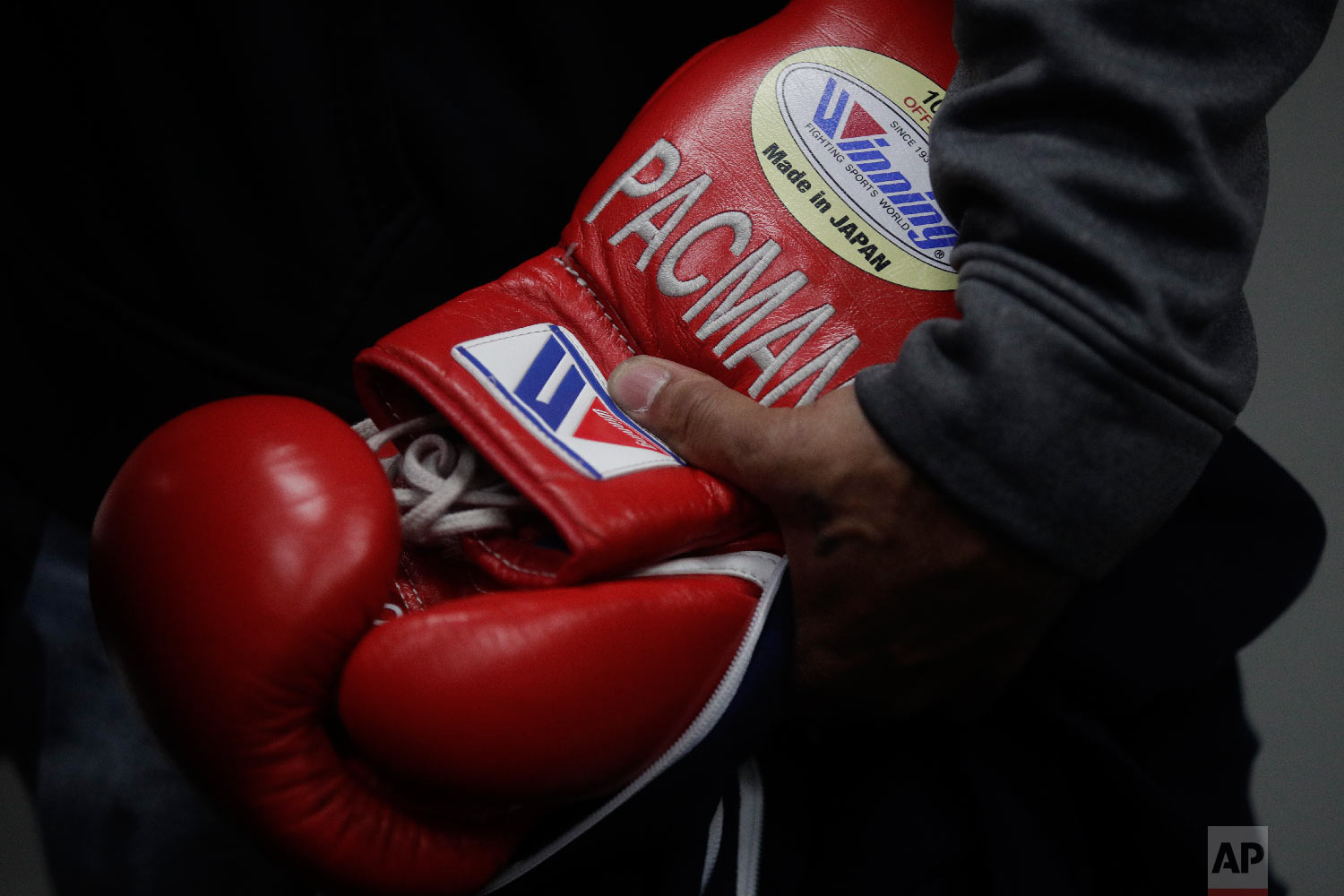 A trainer holds Pacquiao's gloves with Pacquiao's nickname. (AP Photo/Jae C. Hong)