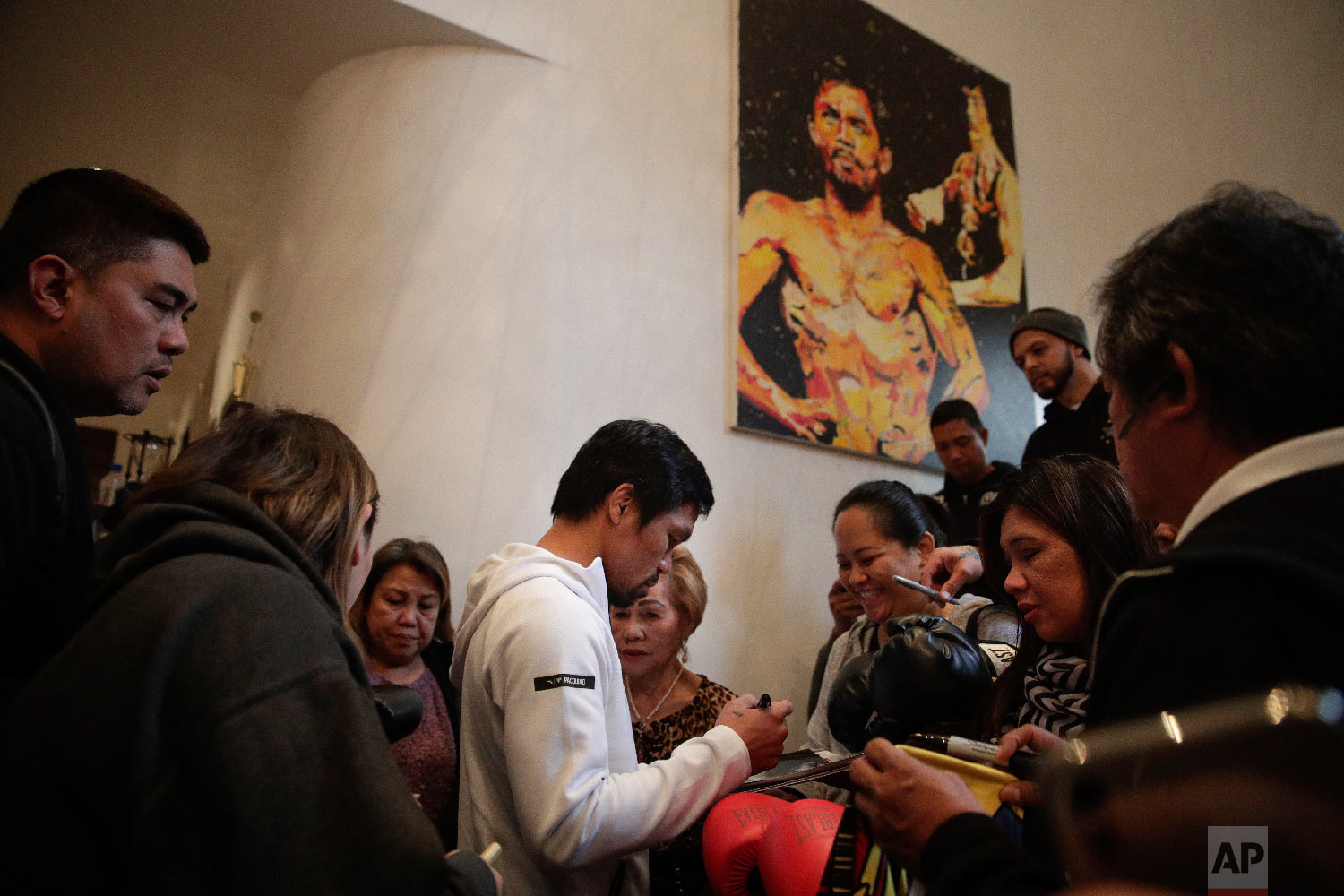 Boxer Manny Pacquiao is surrounded by guests at his home Jan. 14, 2019, in Los Angeles. (AP Photo/Jae C. Hong)
