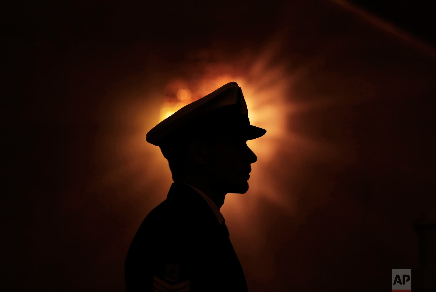 A Libyan honor guard stands at attention during the arrival of U.N. Special Envoy to Libya Bernardino Leon in Tripoli, Thursday, Jan. 9, 2015. (AP Photo/Mohamed Ben Khalifa)
