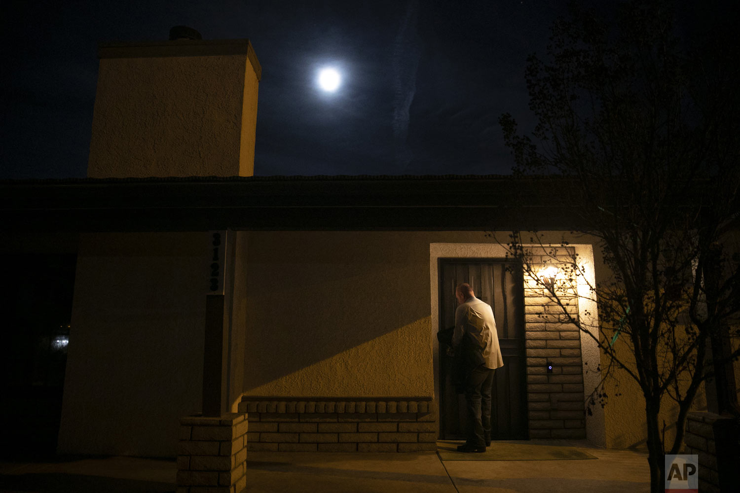 """Chris George, a federal employee furloughed from his job as a forestry technician supervisor for the U.S. Department of Agriculture Forest Service, leaves his home for a free meal offered to federal workers affected by the government shutdown in Hemet, Calif., on Saturday, Jan. 19, 2019. """"I have a lot of pride, so asking for help is difficult for me. It's very difficult for me because I'm always the one giving back or putting myself before anybody else,"""" said George. """"Now, here I am in the situation where I'm the one that is in need."""" (AP Photo/Jae C. Hong)"""