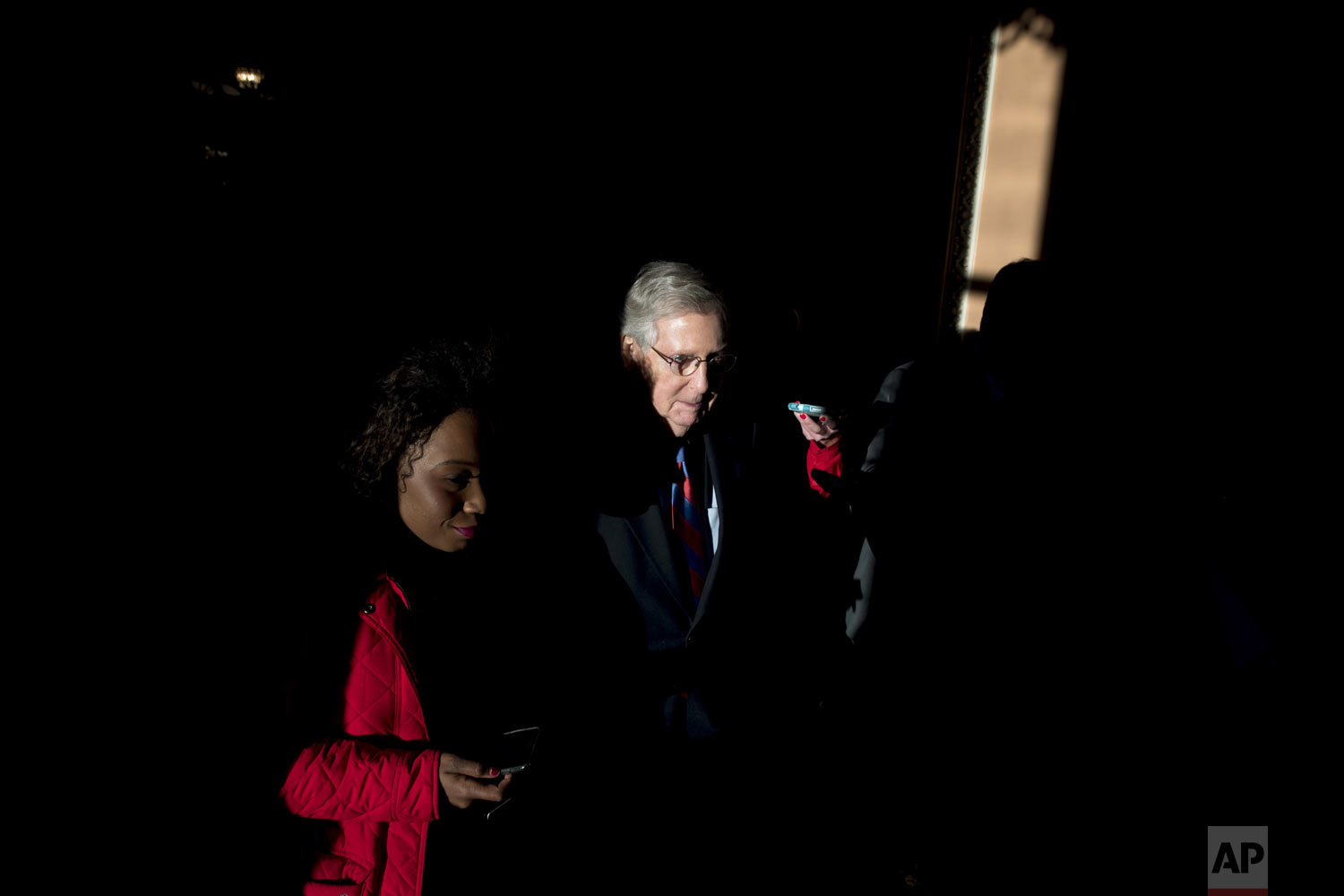 Senate Majority Leader Mitch McConnell, R-Ky., walks out of the Senate Chamber after passing a continuing resolution to reopen the government, on Capitol Hill in Washington, on Friday, Jan. 25, 2019. (AP Photo/Andrew Harnik)