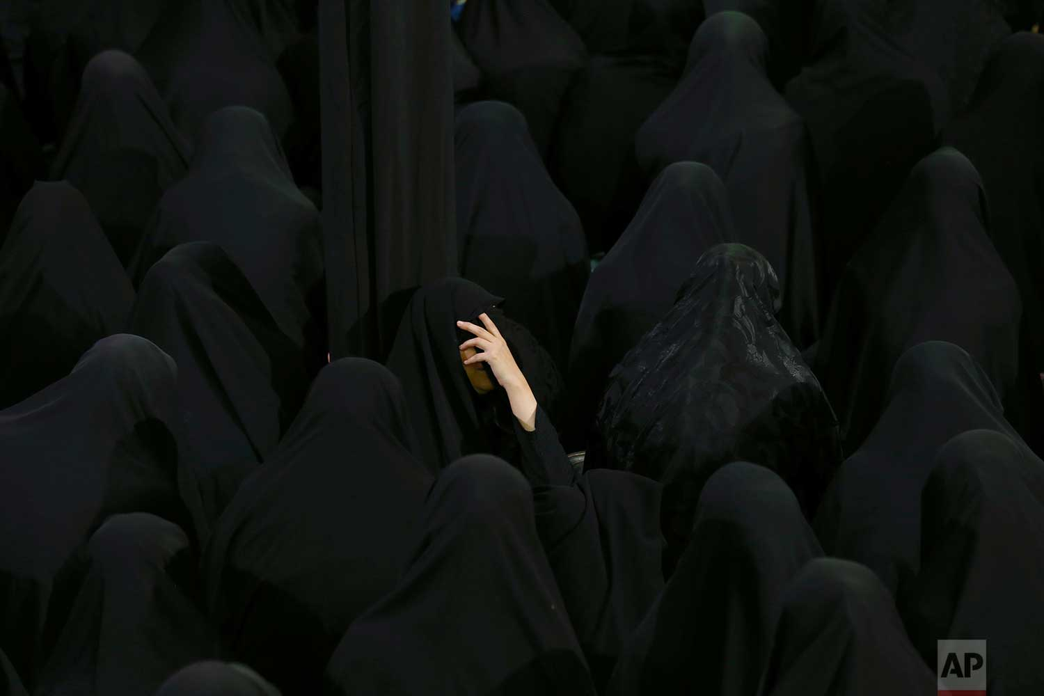 Muslim Shiite women mourn during the holy day of Ashoura, at the Sadat Akhavi Mosque in Tehran, Iran, Thursday, Sept 20, 2018. Ashoura is the annual Shiite commemoration of the death of Imam Hussein, the grandson of the Prophet Muhammad, at the Battle of Karbala in present-day Iraq in the 7th century. (AP Photo/Ebrahim Noroozi)