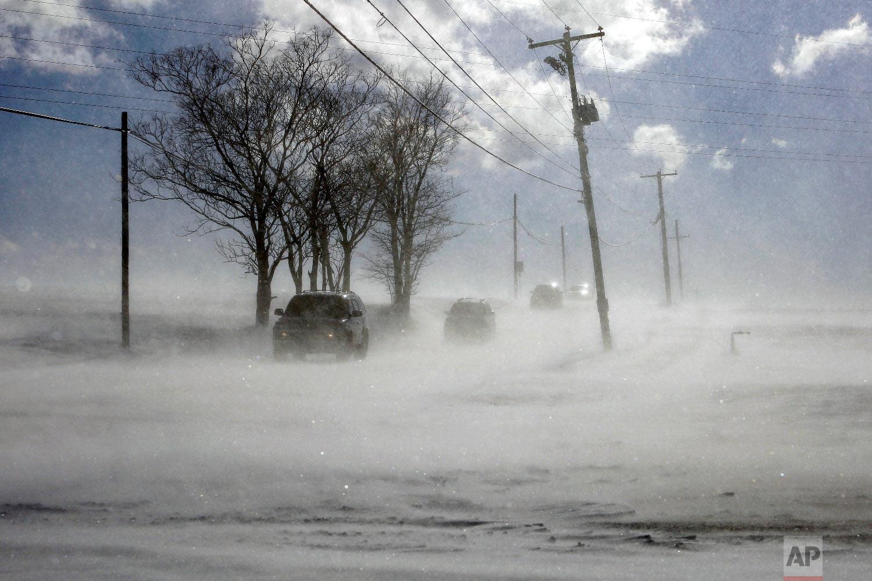Drifting snow blows across PA-772 near Mount Joy in Lancaster County, Pa. Wednesday Jan. 30, 2019.  (AP Photo/Jacqueline Larma)