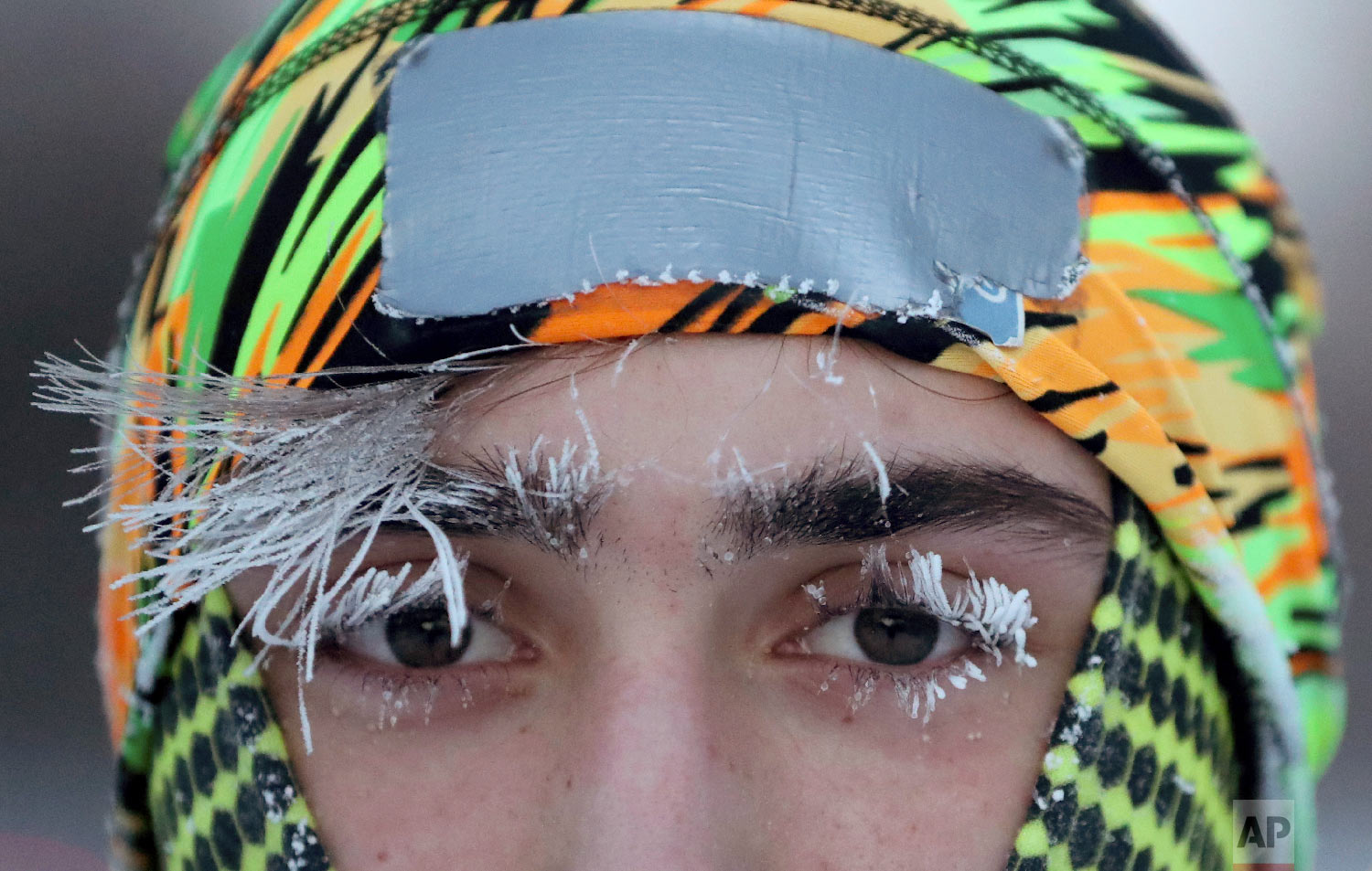Frost covers part of the face of University of Minnesota student Daniel Dylla during a morning jog along Mississippi River Parkway Tuesday, Jan. 29, 2019, in Minneapolis. (David Joles/Star Tribune via AP)