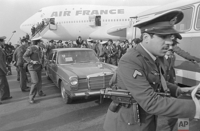 In this Feb. 1, 1979 photo, Ayatollah Ruhollah Khomeini has a heavy escort as he enters car to leave the airport in Tehran, Iran.(AP Photo)