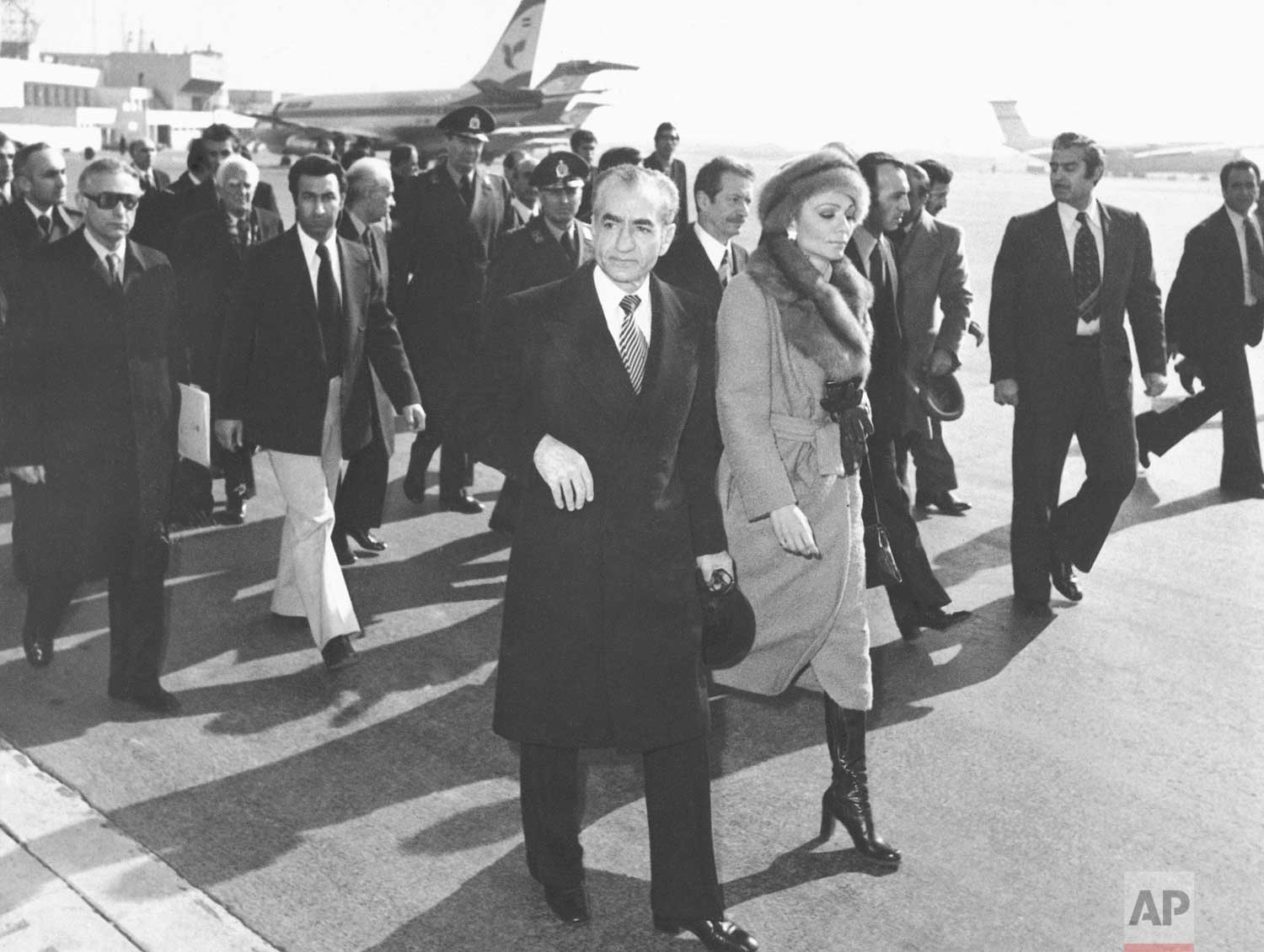 In this Jan. 16, 1979 photo, Shah Mohammad Reza Pahlavi and Empress Farah walk on the tarmac at Mehrabad Airport in Tehran, Iran, to board a plane to leave the country.  (AP Photo)