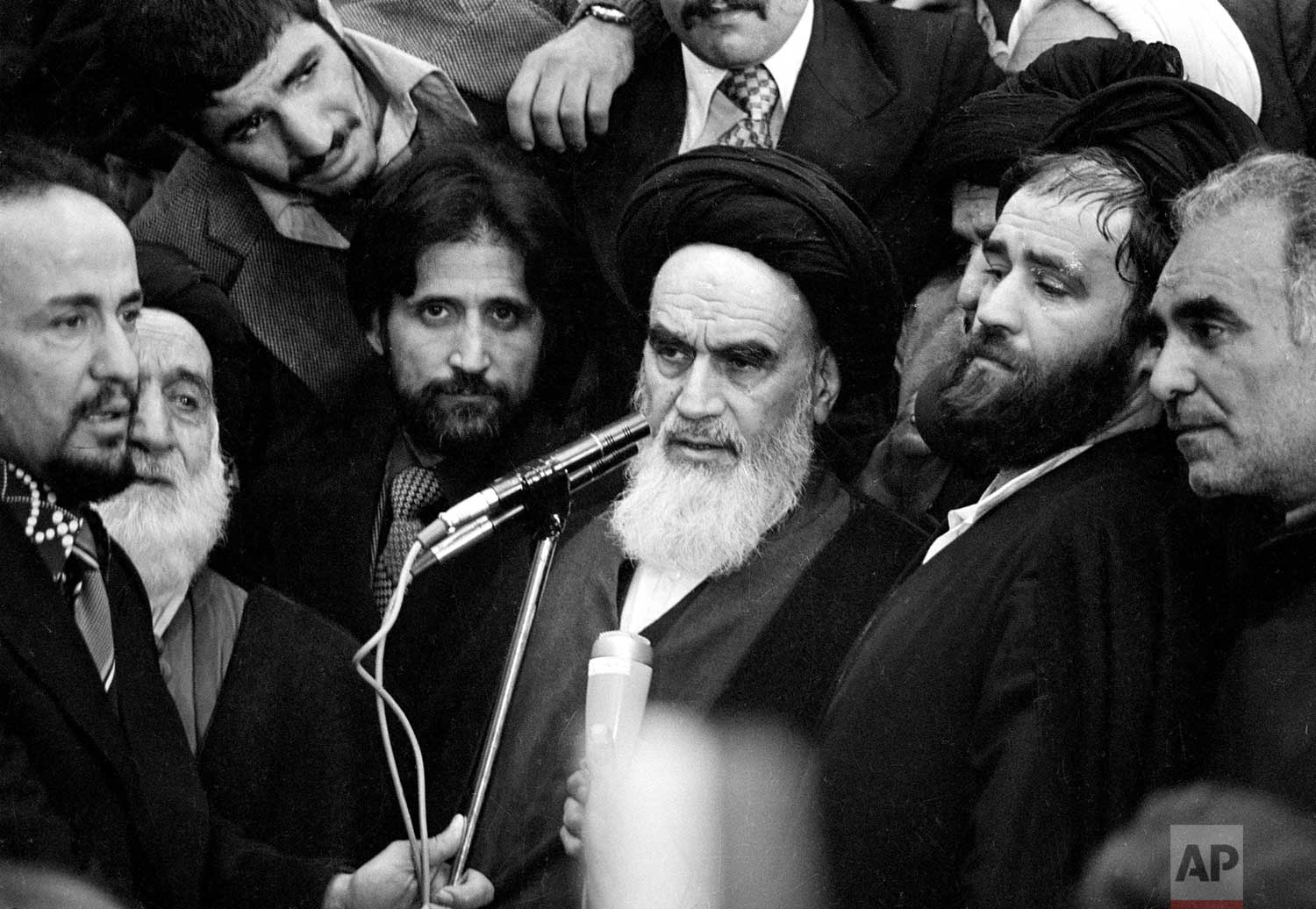 Ayatollah Khomeini addresses an audience in the airport building in Tehran, Iran, Feb. 1, 1979, after his arrival from 14 years of exile. (AP Photo)