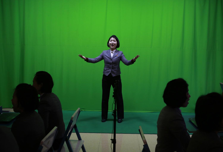 A student sings in front of a green screen during a computer graphics class at Pyongyang Teachers' University, a teacher training college, in Pyongyang, North Korea, on Tuesday, Jan. 29, 2019. (AP Photo/Dita Alangkara)