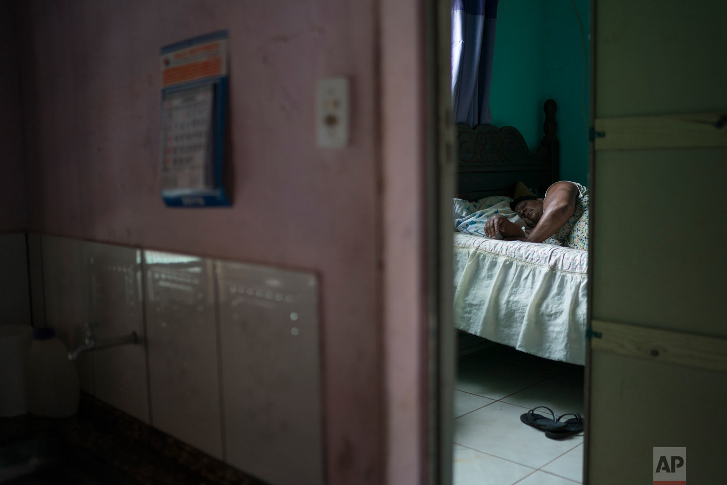 Malvina Firmina Nunes, whose adult son went missing after a Vale dam collapse, sleeps after taking sedatives at home in Brumadinho, Brazil, Jan. 30, 2019, two days before his body was recovered from the mud. (AP Photo/Leo Correa)