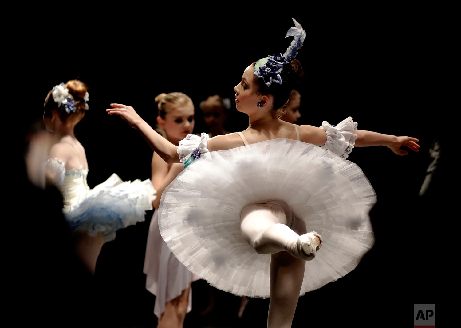 Eva Balicki, right, and young ballet dancers warm up for the Youth America Grand Prix North America regional semi-finals in River Forest, Ill. (AP Photo/Nam Y. Huh)