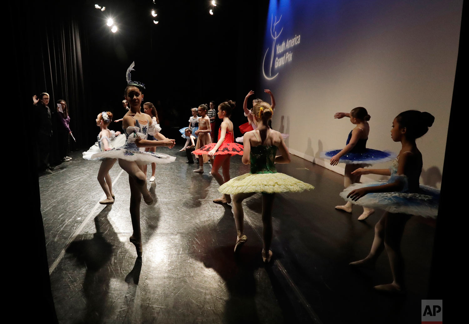 Young dancers warm up for the Youth America Grand Prix North America regional semi-finals at Dominican University Performing Arts Center in River Forest, Ill. (AP Photo/Nam Y. Huh)