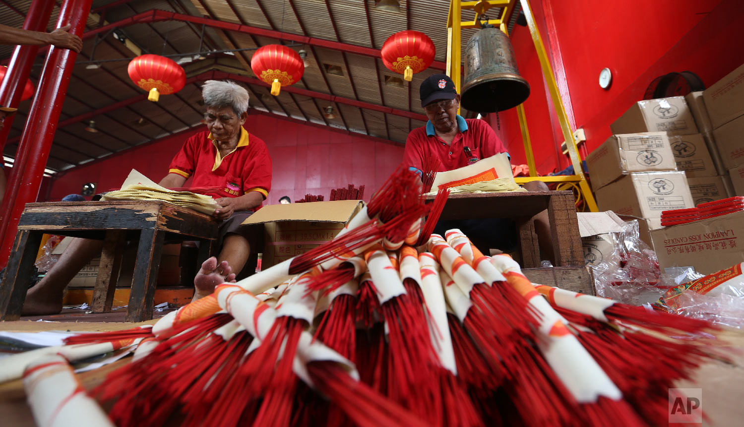 Workers prepare for the Lunar New Year at the Dharma Bakti Temple in Chinatown area of Jakarta, Indonesia, Monday, Jan. 28, 2019. (AP Photo/ Achmad Ibrahim)