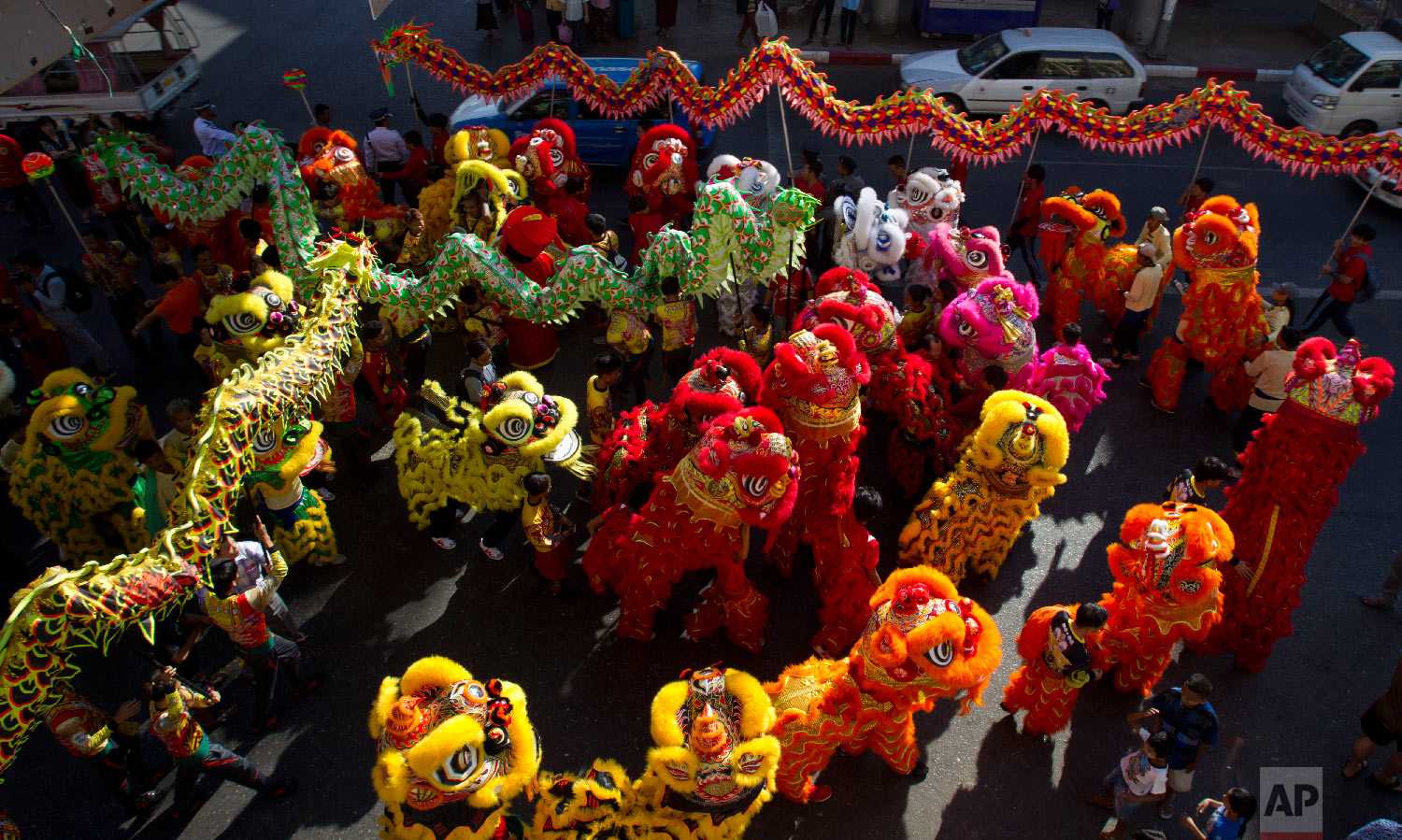 Multiple dragon dances take part in Lunar New Year celebrations in the Chinatown area of Yangon, Myanmar, Tuesday, Feb. 5, 2019. (AP Photo/Thein Zaw)