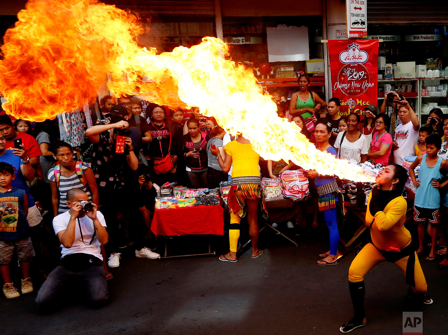 Fire-eater performs during celebrations of the Lunar New Year in the Chinatown district of Manila, Philippines, Tuesday, Feb. 5, 2019.  (AP Photo/Bullit Marquez)