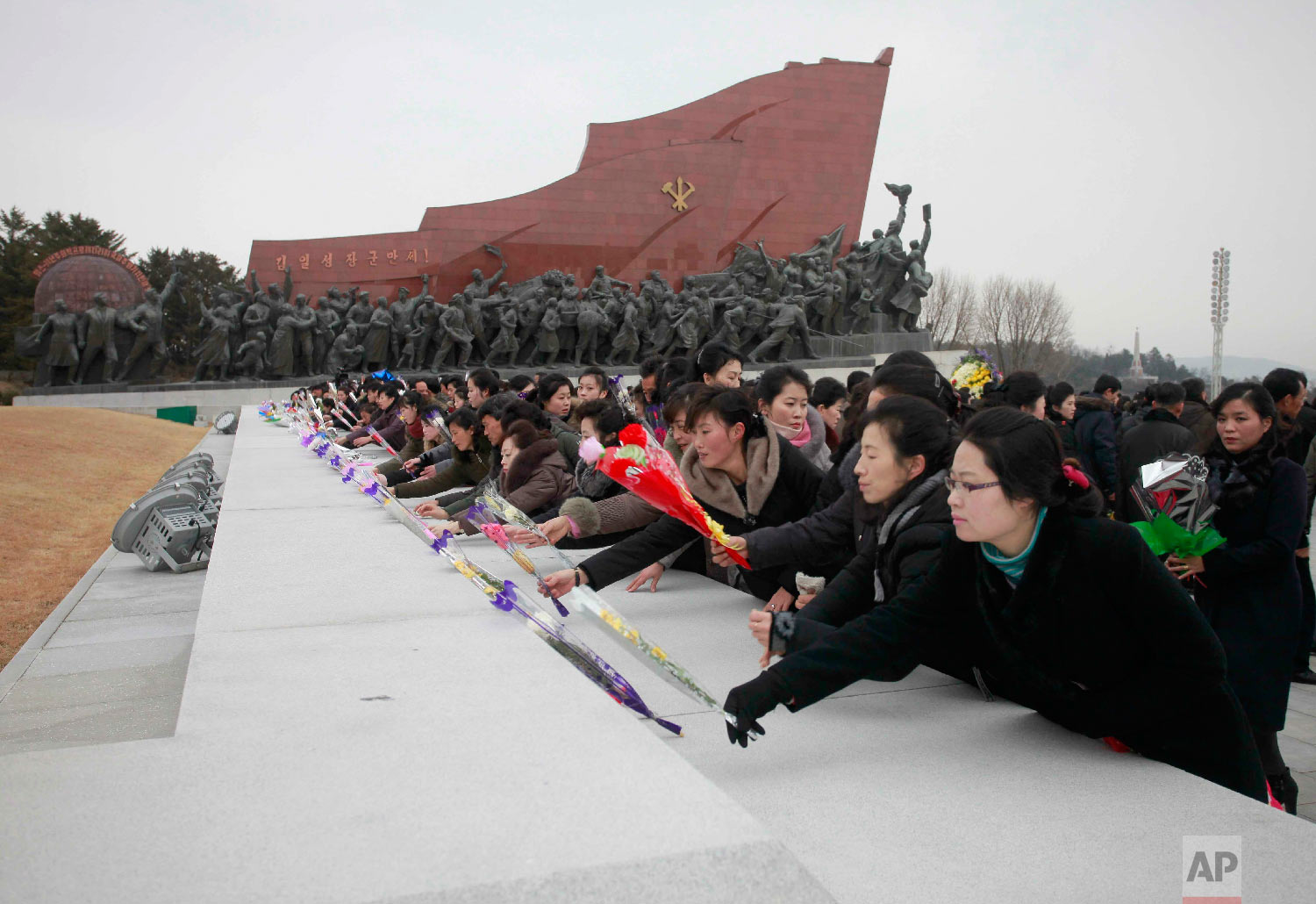 People visit statues of North Korean late leaders, Kim Il Sung and his son Kim Jong Il, to lay bouquets of flowers on the Lunar New Year in Pyongyang, North Korea, Tuesday, Feb. 5, 2019. (AP Photo/Jon Chol Jin)