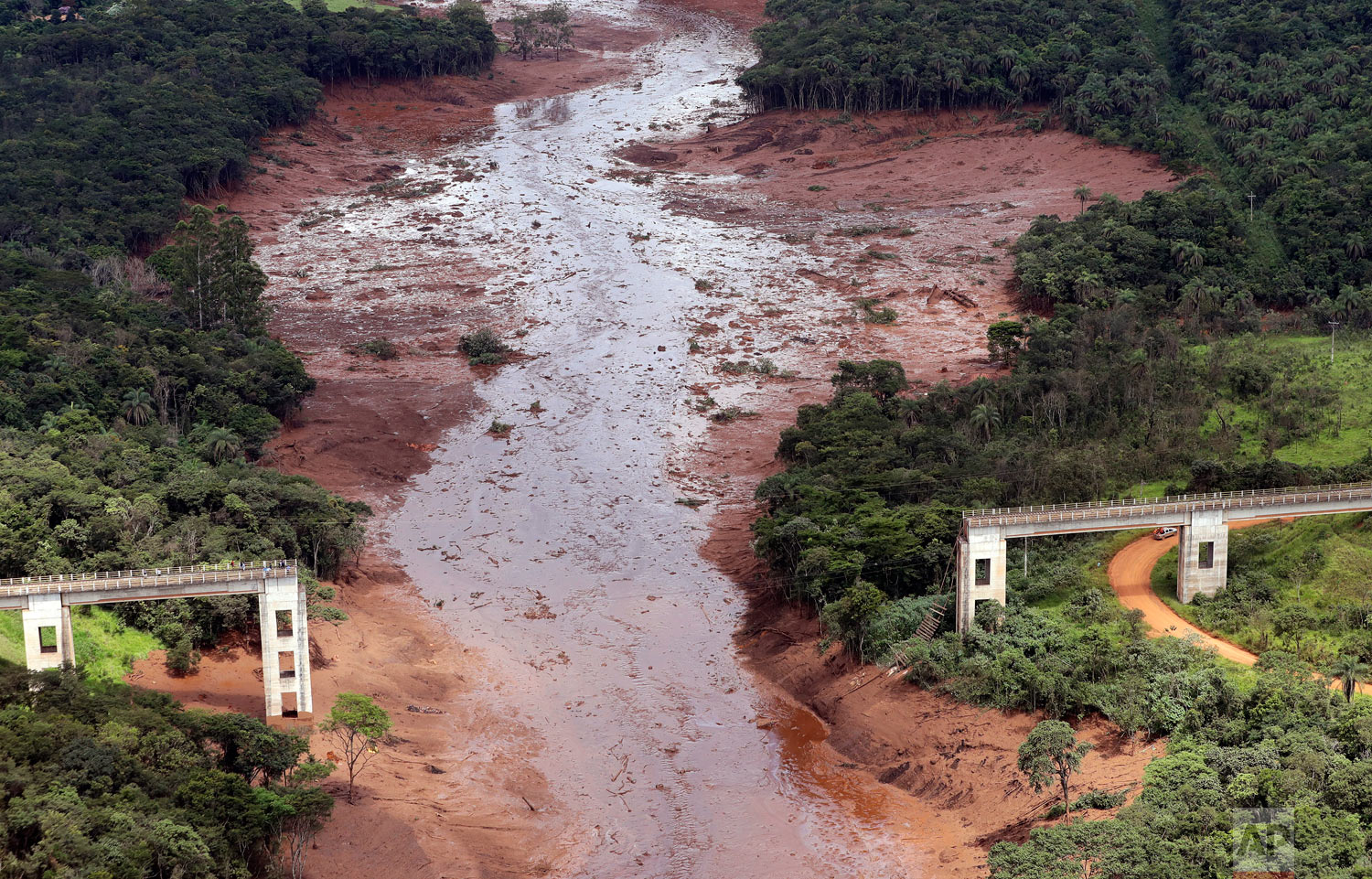 A bridge is destroyed after a dam collapsed in Brumadinho, Brazil, Jan. 26, 2019. Rescuers searched for survivors in a huge area in southeastern Brazil buried by mud from the collapse of dam holding back mine waste.(AP Photo/Andre Penner)