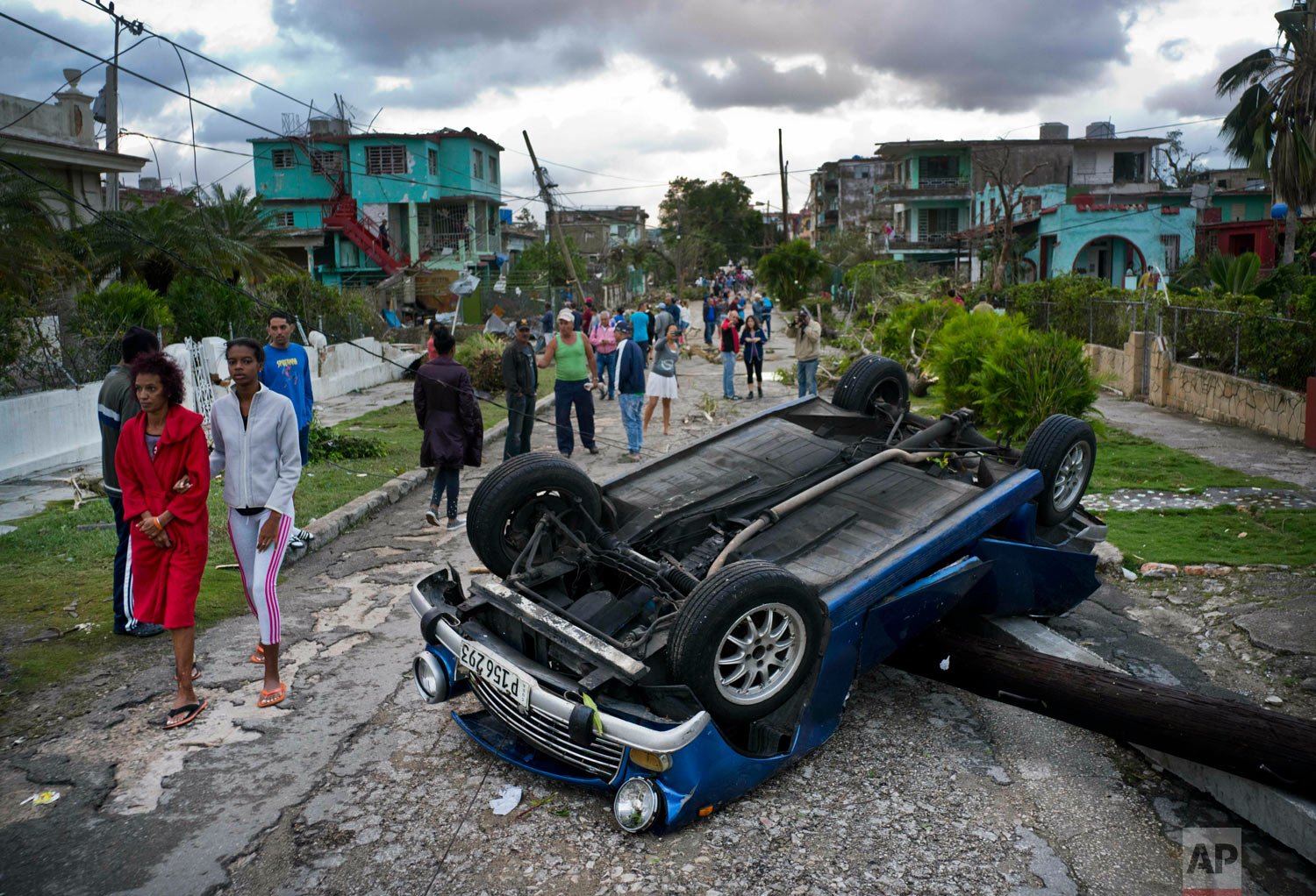 A car overturned by a tornado lays smashed on top of a street pole in Havana, Cuba, Jan. 28, 2019. (AP Photo/Ramon Espinosa)